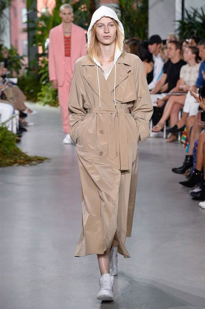 Lacoste Fall 2016: Julia Nobis walks the runway in tan trench coat over hooded…