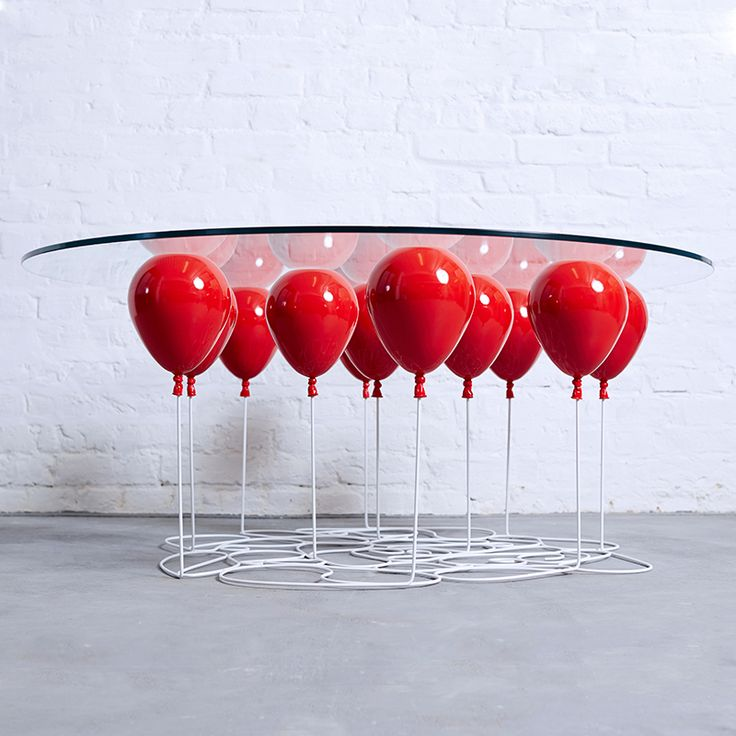 A Glass Table that Appears to be Held Aloft by Helium Balloons  http://www.thisiscolossal.com/2015/03/up-balloon-table-duffy-london/
