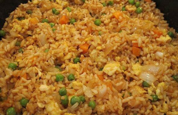 The Pampered Chef fried rice. 3c cooked rice, 2T sesame oil, 1c frozen peas & carrots, 1 sm onion diced, 1t minced garlic, 2 eggs slightly beaten, 1/4c soy sauce.