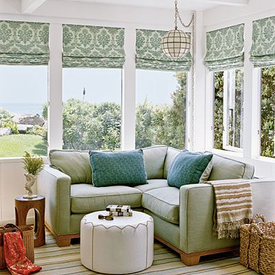 This designer used a classic print on window treatments to create traditional coziness. Gentle blues are warmed by natural light from wraparound windows, making this nook the ideal daydreaming spot.