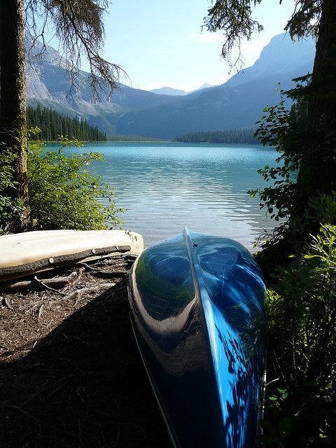 Just you & a canoe, breathing in the fresh air on a perfect crystal clear mountain lake