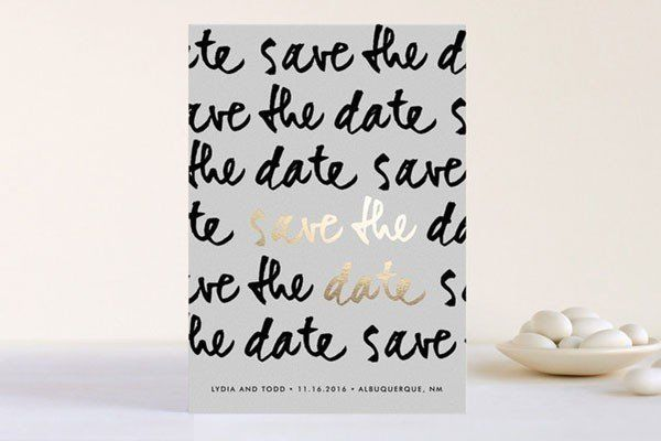 modern save the date with black and gold bold cursive script
