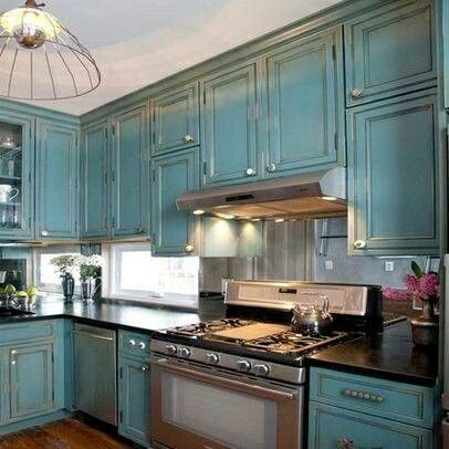 15 perfectly distressed wood kitchen designs blue for Blue distressed kitchen cabinets