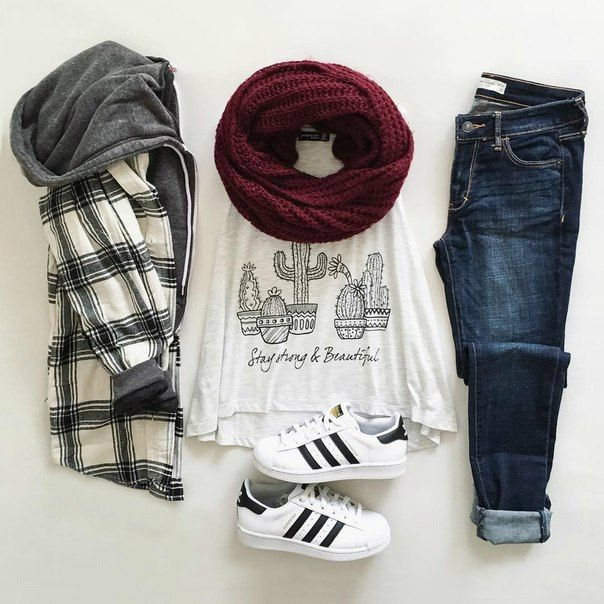 Black and white flannel hooded jacket, cotton t-shirt, knitted scarf, blue jeans and Adidas black and white sneakers - http://ninjacosmico.com/17-hipster-outfits-try-spring/