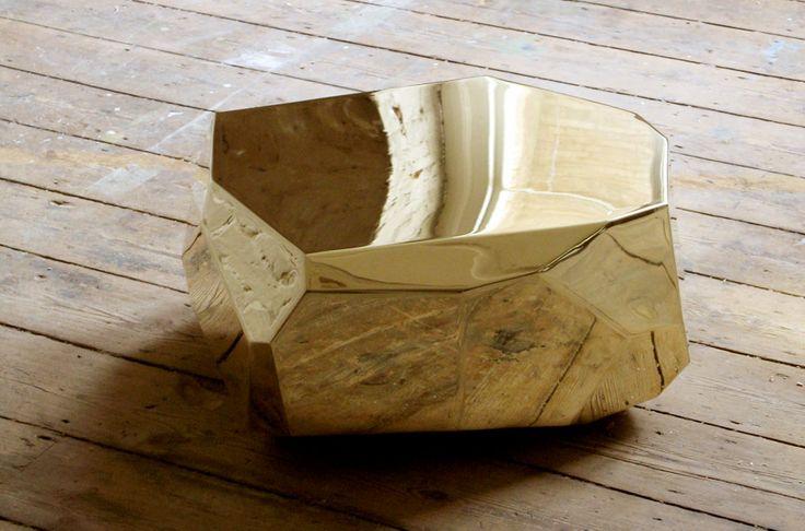 polished brass rock table::pas mal la création d'une matière par la réflexion de l'une dans l'autre!! pour pas trop cher, on peut avoir des effets sympa entre le bois le béton le carrelage et les miroirs plus ou moins courbes.. Arik Levy rock brass