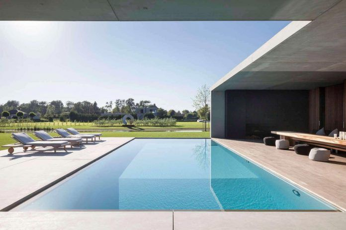 Modern VDB Residence: a long floating horizontal concrete framework made up by 2 volumes - CAANdesign | Architecture and home design blog
