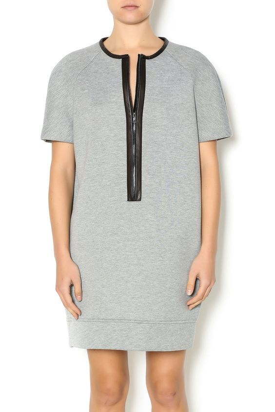 Grey neoprene short sleeve tunic dress with front half zipper detail and faux leather detail around the neck and chest.