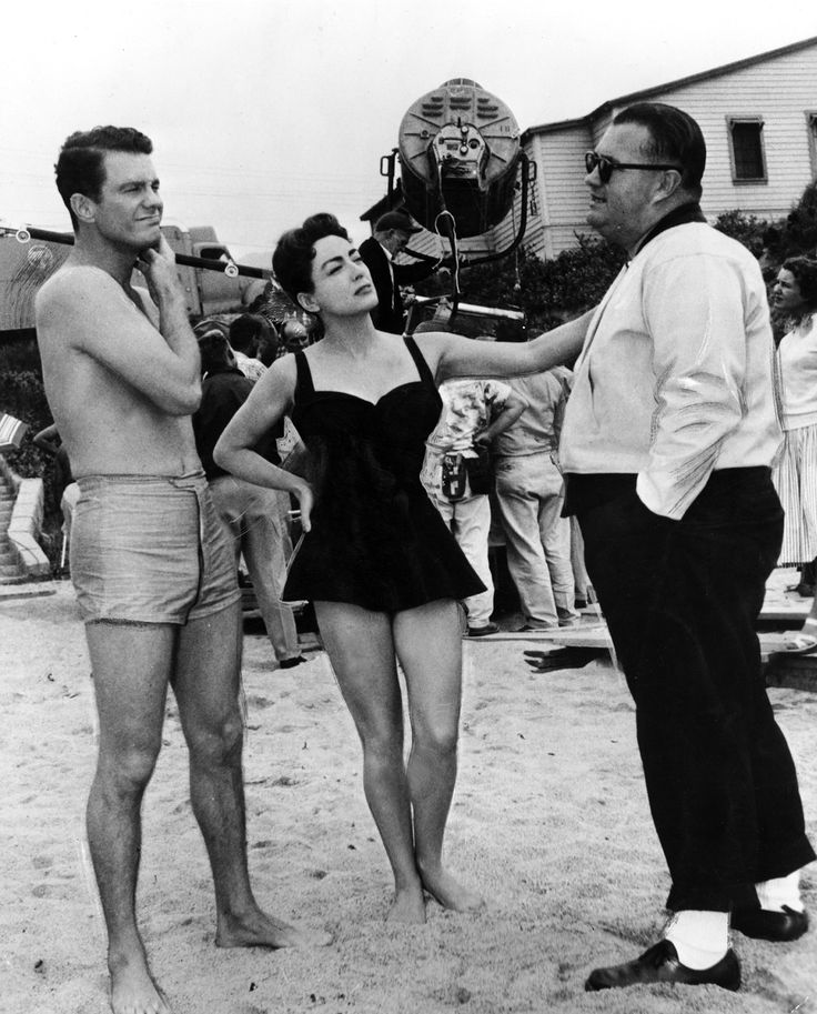 Cliff Robertson and Joan Crawford listen to director Robert Aldrich while filming the beach scene for Autumn Leaves (1956)