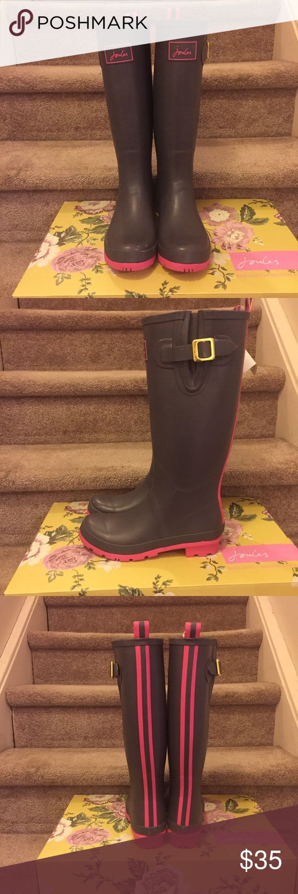 Gray & pink Joules wellies aka rain boots NWT Joules Wellies boots. Great color combination of gray and pink. Super cute on! Size is 7. Minor scruff on left shoe. Please see last photo for a more of close up of scruff. Great pair of rainboots! please feel free to ask any questions. Joules Shoes Winter & Rain Boots