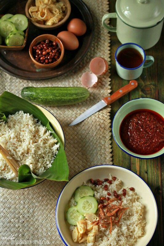 Nasi Uduk. White rice cooked with coconut milk and herbs. Betawi dish. Jakarta, Indonesia.