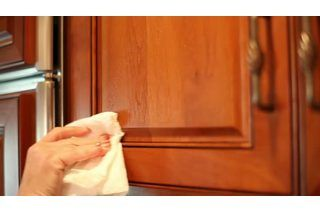 Over time, grease and grime can build up on your stained wood kitchen cabinets and make them look dirty and dull. When this happens, you'll find you can instantly update the look of your kitchen when you clean and polish wood cabinets. Cleaning removes all of the nasty build-up that occurs, and polishing helps restore the luster and shine...