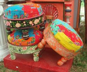 Junk Gypsies stools.  Not really chairs but how cute in front of one!