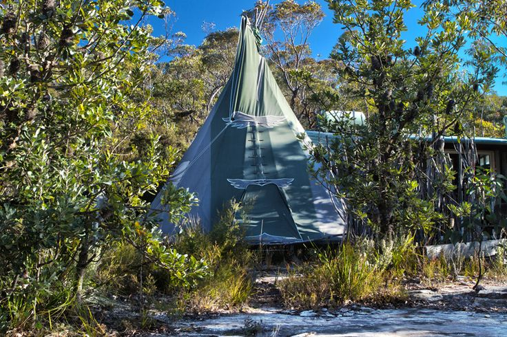 "Set amongst an interesting outcrop of rock formations, the Love Tee Pee has through-tree views over beautiful Blue Mountains wilderness. Opening floor-to-ceiling windows in the annex allow the surrounding ridge-top bushland to flow into the very feel of this unique, ""primitive-style"" dwelling. A track behind the Love Tee Pee leads down the hill to various lookouts and the trail going down to Bowen's Creek."