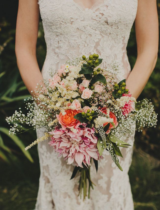A vintage inspired wedding bouquet that will be sure to draw some welcomed attention. Complete with pale colored flowers and sprigs of babies breath, this bouquet is anything but plain. See more wedding ideas here: http://greenweddingshoes.com/stylish-oregon-farm-wedding-thea-colin/