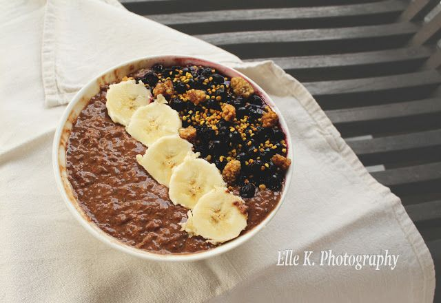 Nutritious Vegan Chocolate bowl topped with super healthy berries! Plantbased breakfast power!