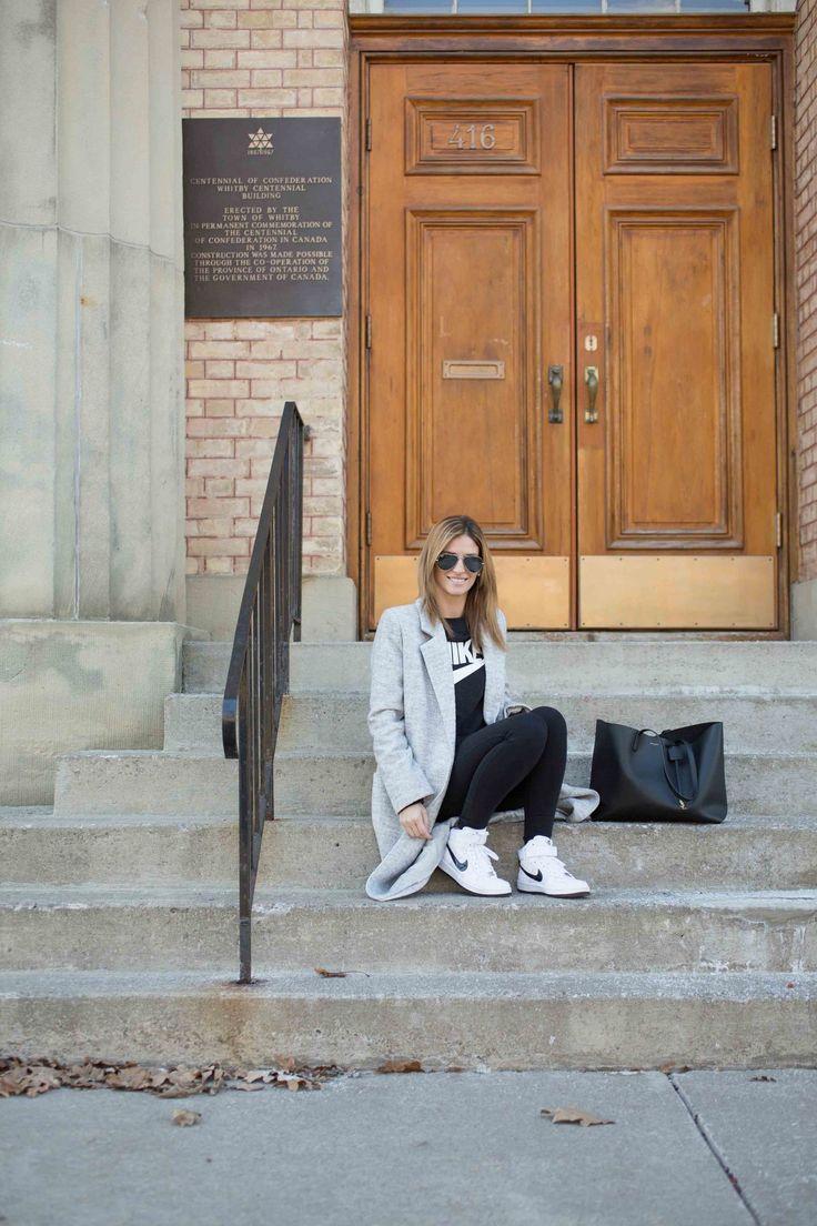 Long grey coat, black Nike sweatshirt, black workout leggings, Nike women's high tops, black leather Saint Laurent shopper