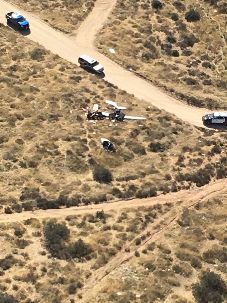 In this image released by the Los Angeles County Sheriff Department shows the scene of a plane crash late Sunday, Feb 11, 2018, morning in a remote area near Agua Dulce, Calif. Authorities say four people have been killed in the crash of a small plane near a mountain town in Southern California. Agua Dulce is in the Sierra Pelona Mountains about 40 miles (73 km) north of downtown Los Angeles. (Los Angeles County Sheriff Department/Special Enforcement Bureau/Air Rescue 5 via AP)
