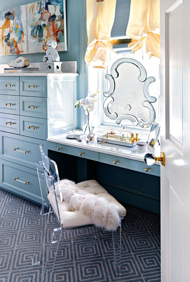 A curvy, elegant mirror at the vanity adds an extra dose of luxury to this pretty space. - Photo: Dustin Peck / Design: Gray Walker