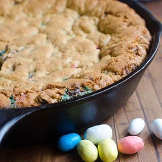 Heads up! Save some of that Easter candy the Easter Bunny brings this weekend so you can make this Easter Candy Skillet Cookie! 🍪🍪🍪 #linkinprofile #easter #eastercandy #malted #castironskillet
