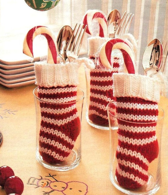 Holiday Tablescapes - use tiny stockings to hold cutlery (and a sweet), stand in drinking glasses....♥
