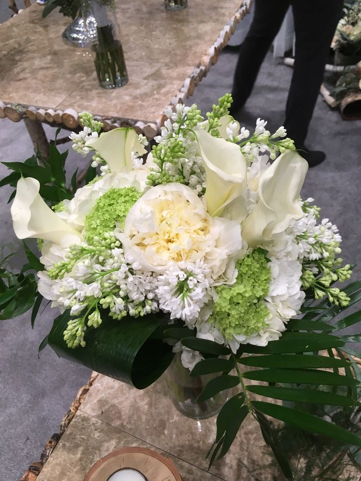 White lilac, peony and callas.