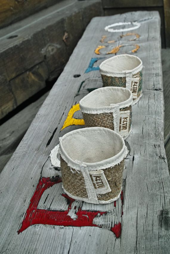These coffee sleeves are upcycled from burlap coffee bean sacks and reclaimed cotton canvas. They are all unique and fun. 2.5 % of your purchase goes to Alaska Marine Conservation Council. Made by hand in Homer, Alaska.