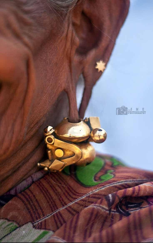 India | Details; woman wearing  traditional 'Bhampadam' earrings | ©Yesmk Photography