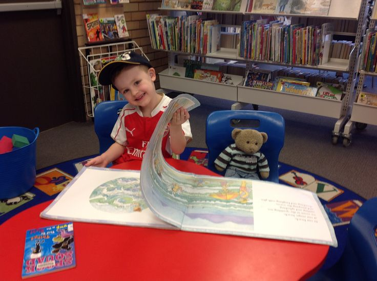 Fun at the library! One of the younger members of #PenshurstBranchLibrary, Harry, reading #MagicBeach by #AlisonLester with his friend #RupertBear in the children's section