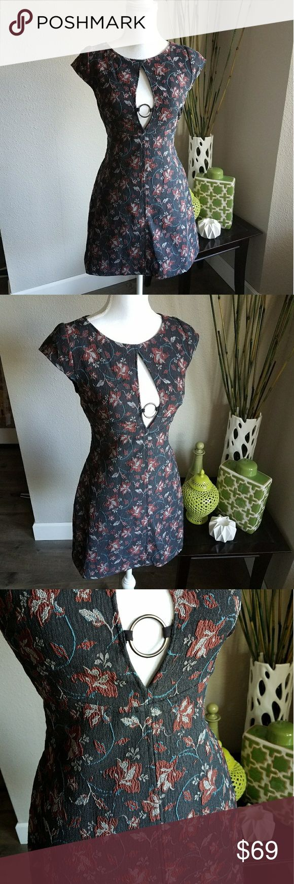 PRICE DROP⬇ Free People floral cut-out dress New with tags.   Gorgeous Free People black floral mini dress.  Absolutely beautiful floral design.   Featuring cut-outs and metal ring details.  Fabric has stretch for comfort.   Perfect for date night or girls night out! Smoke free and pet free home. Free People Dresses