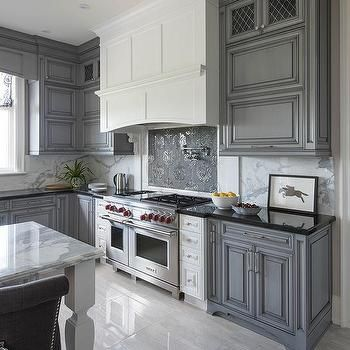 White Kitchen Hood with Dark Gray Mosaic Cooktop Backsplash Tiles
