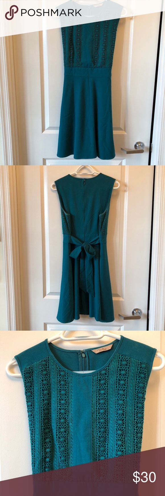 Teal Fit and Flare Eyelet Front Teal Fit and Flare Eyelet Front - Hidden zipper, ties for a bow in the back, heavy fabric for fall, and 39 in (at 5ft10in, it hits me slightly above the knee). It looks fantastic with tights and boots! There is no wear and tear visible on the fabric at all. Dresses