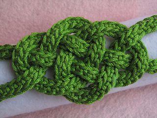 Celtic Knot Bracelet, free crochet pattern by Jennifer E. Ryan: Links to a photo tutorial on weaving the knot.