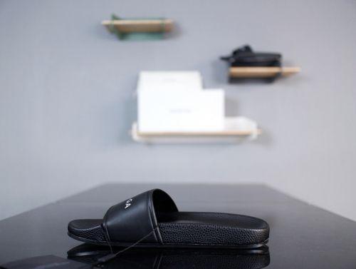 c8c39f4b837e Womens Balenciaga Piscine Flat Sandals With Balenciaga Embossed Logo Black  White