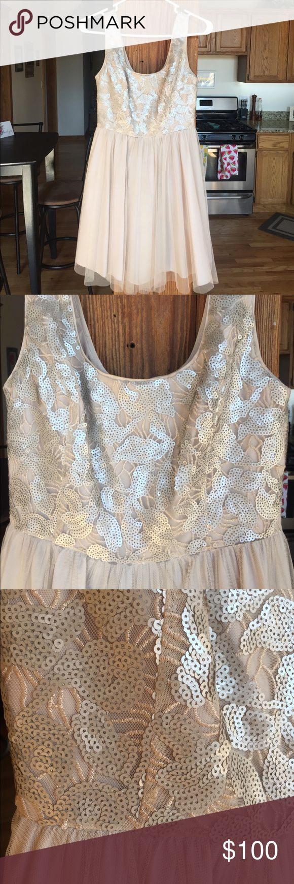 Beige party dress Beautiful beige party dress with sequin top detail and tulle bottom. Only worn once as a bridesmaid dress Aidan Mattox Dresses Asymmetrical