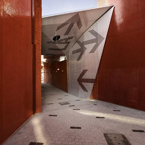 Atelier 9.81 of France have inserted a perforated canopy in between a row of houses to create a covered pedestrian walkway in Tourcoing, France. http://www.atelier981.org/