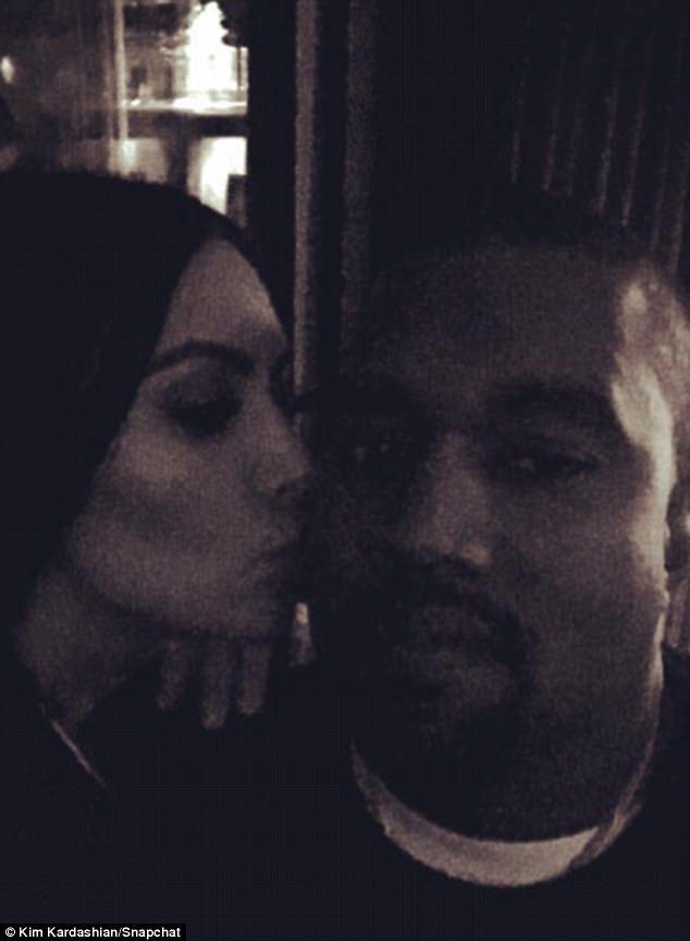 'Fight night!' Kim Kardashian West gave her third husband Kanye West a very public kiss on the cheek Saturday from the comfort of their Calabasas home
