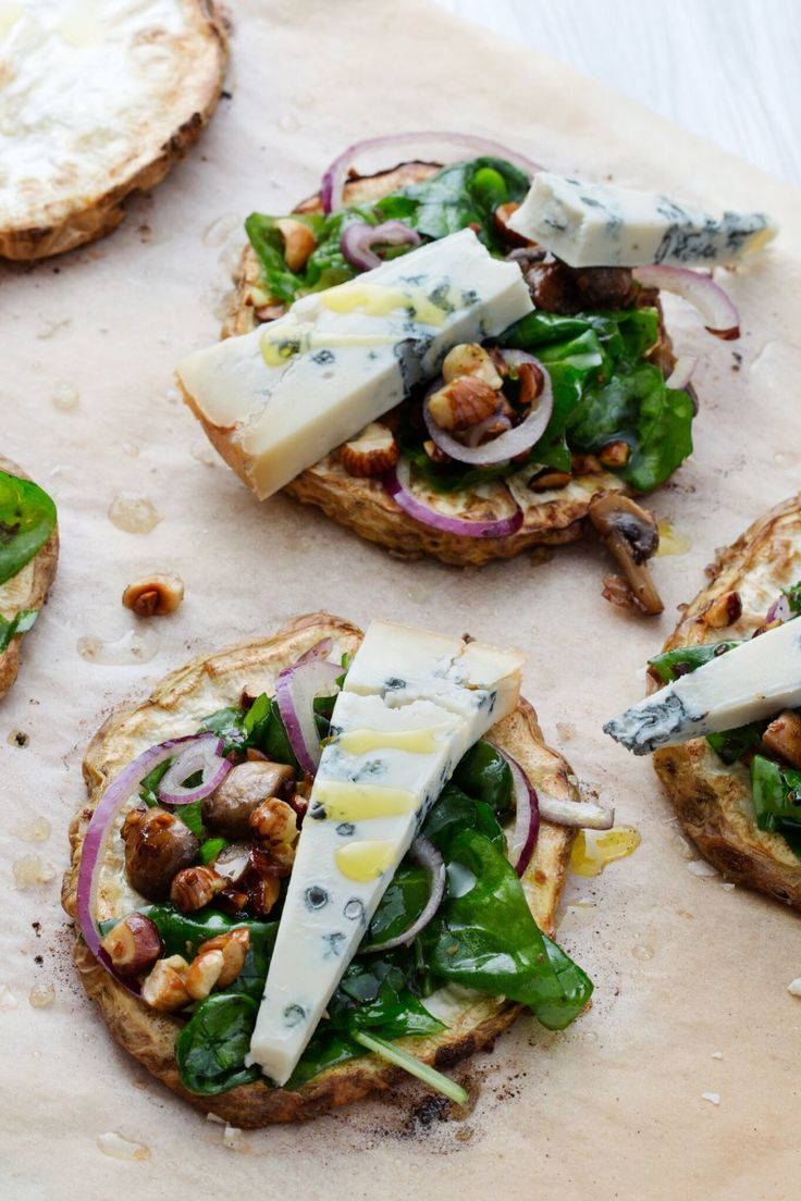 Baked gorgonzola on wilted spinach with pine nuts #dinnerparty #cheeseboard