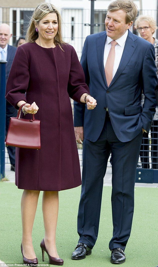Picture perfect: She soon managed to compose herself as she walked arm in arm with her husband, Willem-Alexander, 48