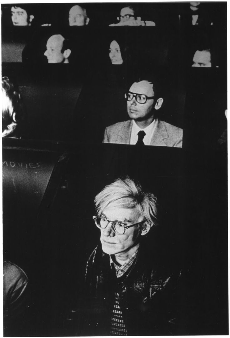 """Andy Warhol watching experimental films at the Anthology Film Archives's """"Invisible Cinema"""", designed by Peter Kubelka"""