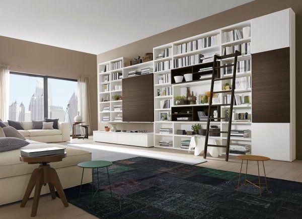 Wohnzimmer Dunkler Teppich Helles Sofa Bibliothek