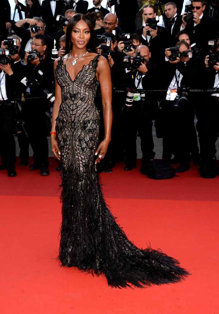 Naomi Campbell walked the red carpet in a slinky Atelier Versace gown with a delicate lace overlay. She wore a Bulgari Serpenti high jewellery suite – a matching necklace, ring and earrings set with pear-cut aquamarines and diamonds. For glamour celebrity fashion Cannes Film Festival red carpet jewellery spotting travel here: http://www.thejewelleryeditor.com/jewellery/top-5/cannes-2017-red-carpet-jewellery-70th-anniversary-party/ #jewelry