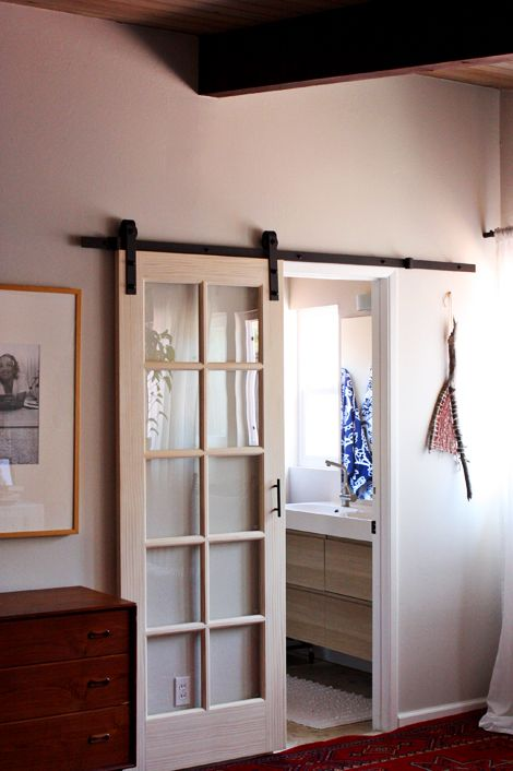 External Sliding Door by Elise Blaha Cripe - hanging barn door hardware from amazon + a door from home depot. I love this!