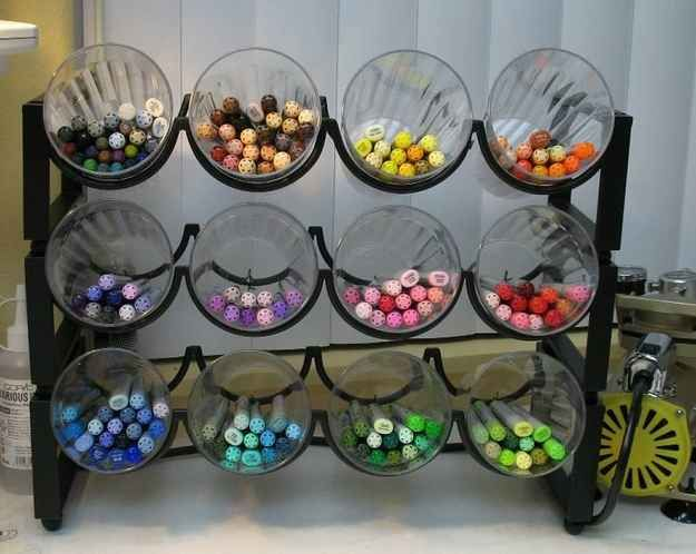 Use a wine rack and plastic cups to store markers.   29 Clever Organization Hacks For Elementary School Teachers