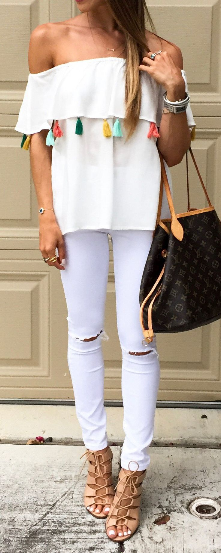 #spring #outfits Tassel Obsessed This Exact One Is Sold Out, But I Linked A Few Others That Are Equally Cute // White Off The Shoulder Top + White Ripped Skinny Jeans + Black Leather Tote Bag