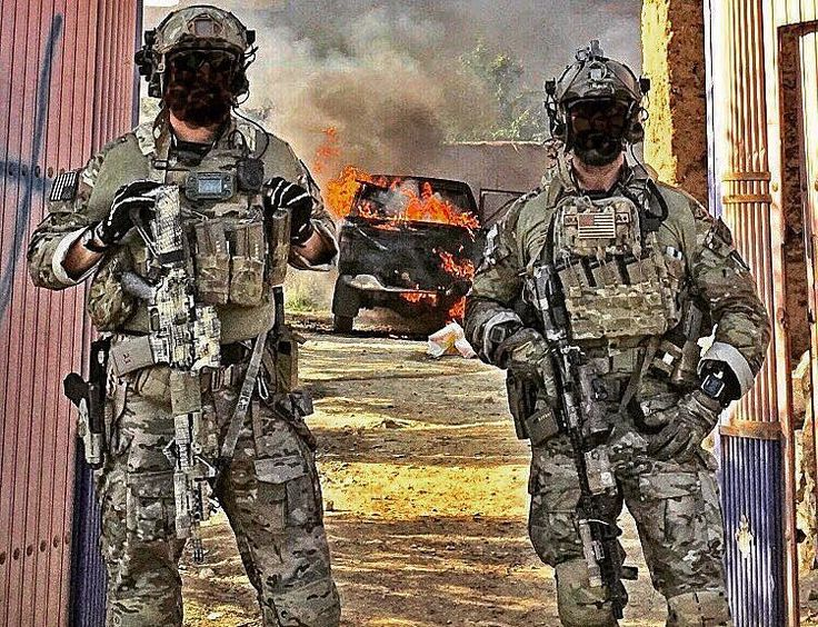 Two U.S. Army Green Berets pictured with a burning car c. 2014-2016. [750 x 575]