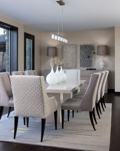 Contemporary Dining Room Design Ideas With White Marble Dining Table And Modern Decorative Wall Arts