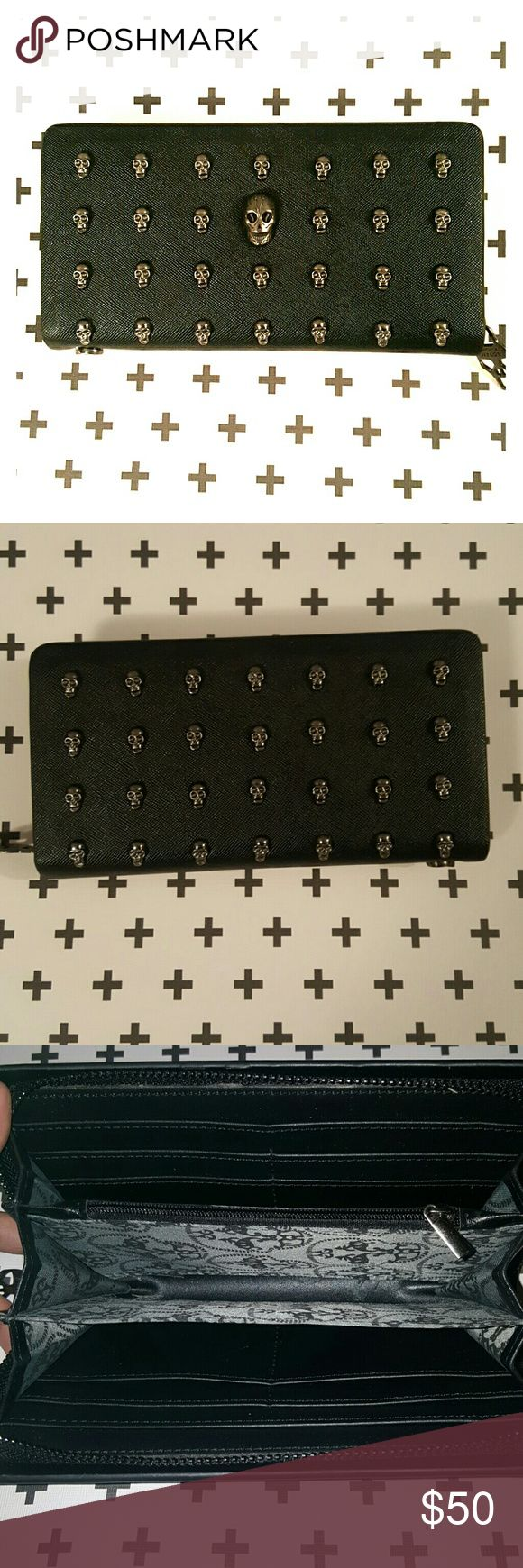 Thomas Wylde black mini skull studded *FINAL* FIRM New!!!! Perfect condition. I never used it. It's black with metal little skulls all over the wallet. Has 12 credit card slots and 4 separators in the wallet. It zips all the way around. NWOT Thomas Wylde  Bags Wallets