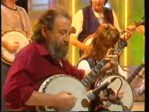 Barney MacKenna from the Dubliners, and his Banjo Band play The High Reel. RIP Barney McKenna, 1939-2012.