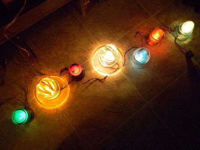 Kimble & Hemingray Glass Insulators Lighted by Old Noma Christmas Light String (3) by mynikonL110-D50pics, via Flickr