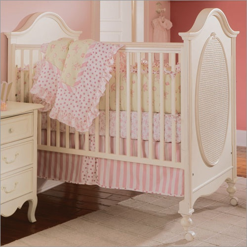 Vintage cream and pink baby room.
